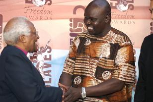Anywar Ricky with Bishop Desmond Tutu during the award ceremony.
